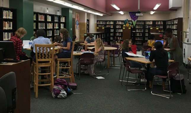 Students working in library during lunch.