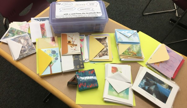assorted cards contributed to fill the library's gratitude box