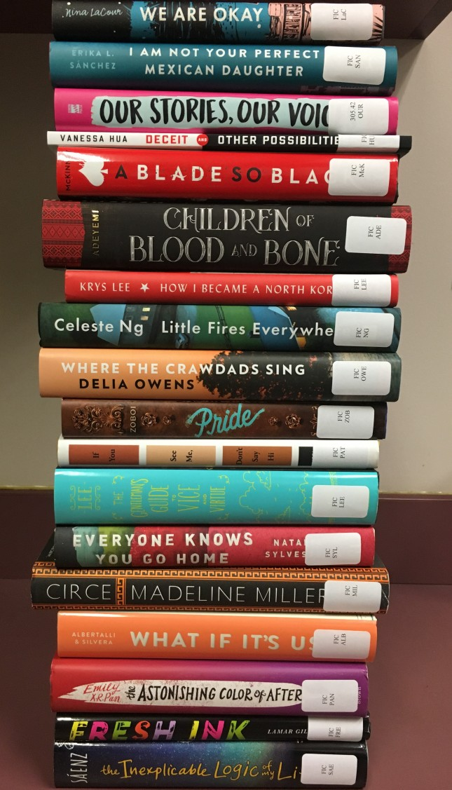 stack of new fiction books