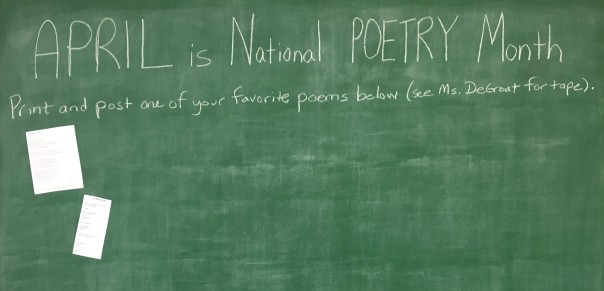 """image of library's message wall that reads """"April is National Poetry Month - Print and post one of your favorite poems below (see Ms. DeGroat for tape)"""""""