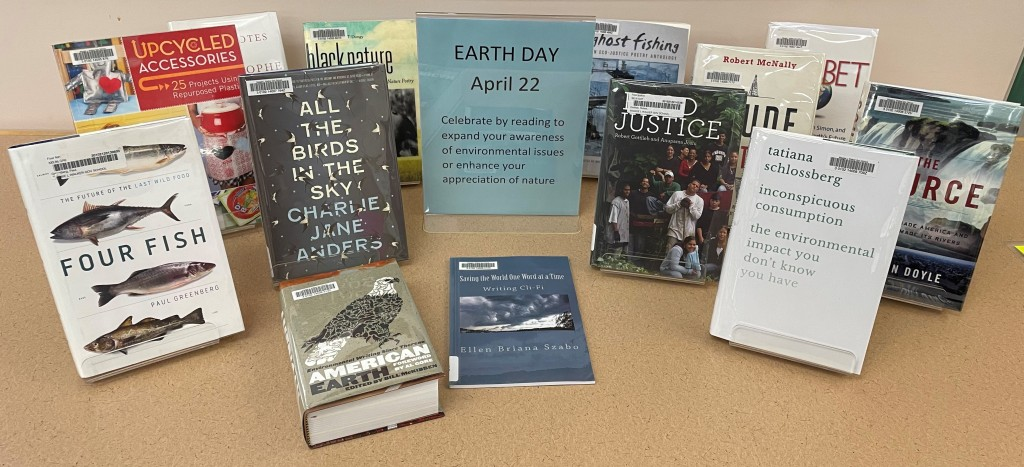 Image of earth-related books included Four Fish, Food Justice, The Source, The Bet, Inconspicuous Consumption, and All the Birds in the Sky.
